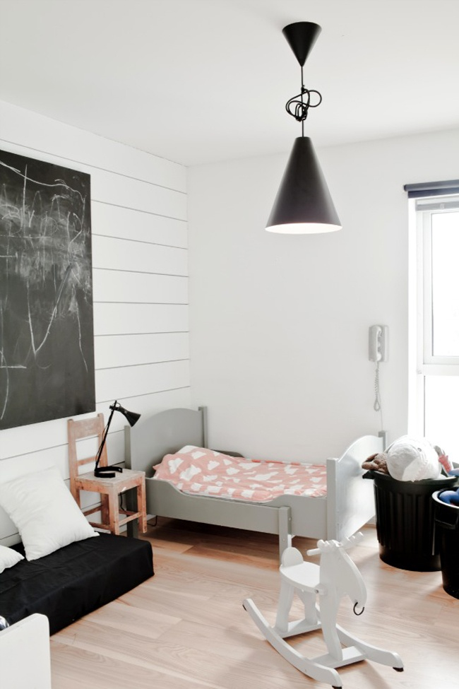 a beautiful simple room . grey black and white