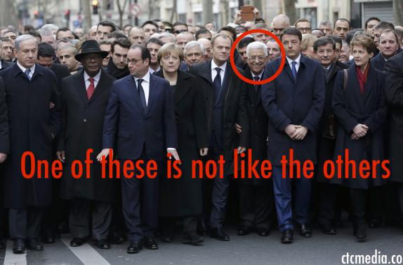 Why is Mahmoud Abbas grinning during a memorial for victims of terrorism?