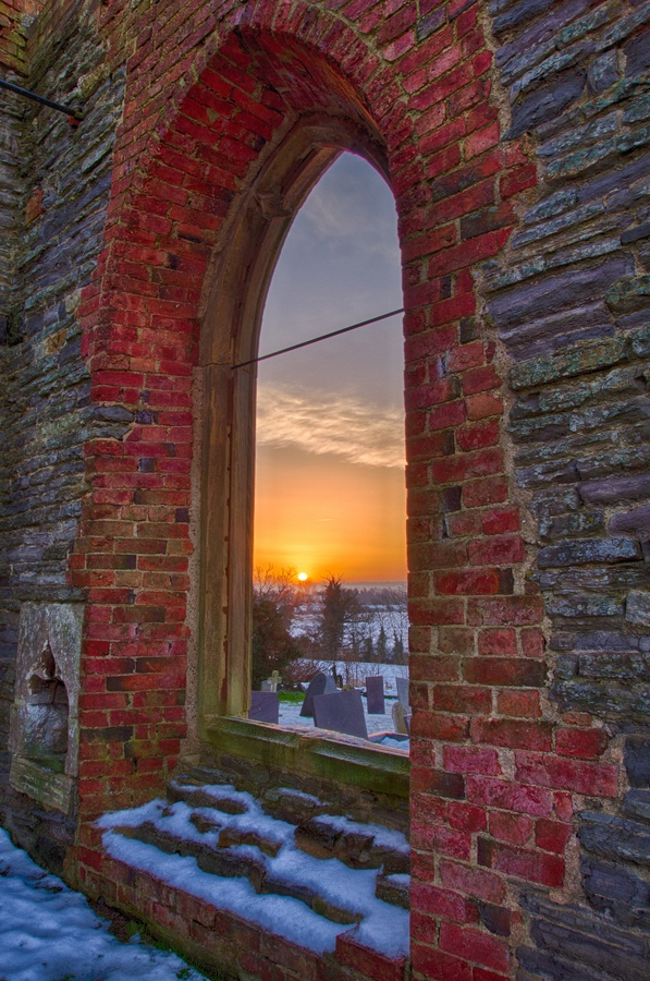 Sunrise through a window at the ruin of St Mary's Church in Nottingham, England. http://www.rentalcarsuk.net/nottingham.html
