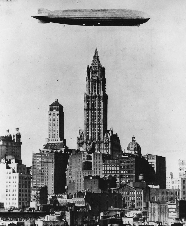 A German zeppelin appears to float above the Woolworth Building in 1928. - Herbert Orth