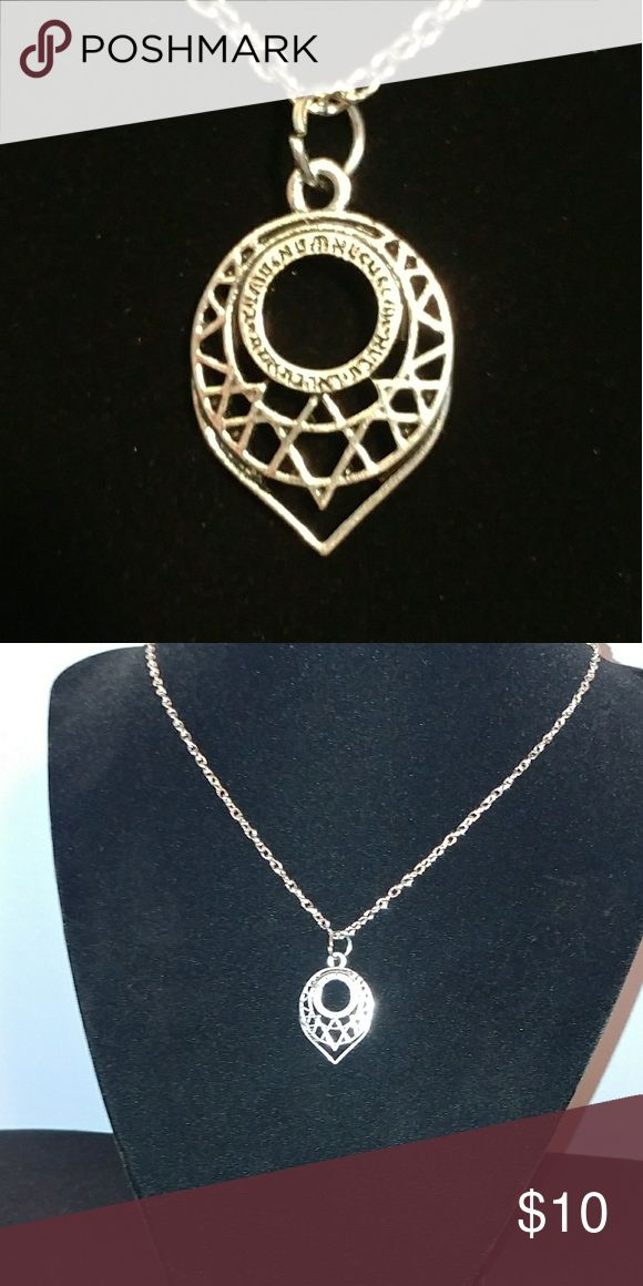 Star of David tear drop pendant necklace Delicate and intricate Star of David pendant with Hebrew writing. Translations are welcome in the comments. Had a hard time translating. Silver tone with necklace included. Jewelry Necklaces