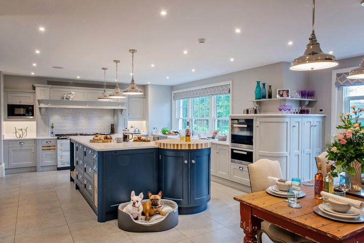 Ovens shouldn't be above elbow height for anyone using them and make sure there is plenty of worktop space nearby, as you don't want people carrying hot dishes far with other people or pets rushing around | Kitchen: Raycross Interiors featuring Miele appliances