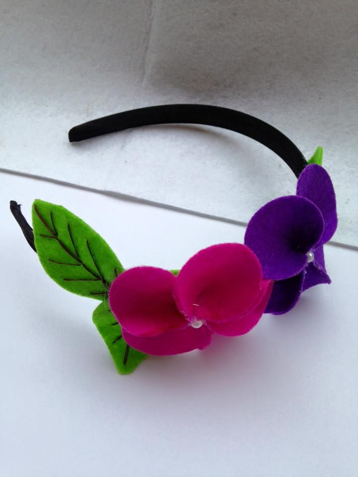 Felt flower hairband with felt leaves created by Joanne's PaperCreations.