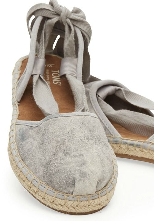 A slingback espadrille in a lovely washed suede. The top can be tied however you see fit. You've got options.