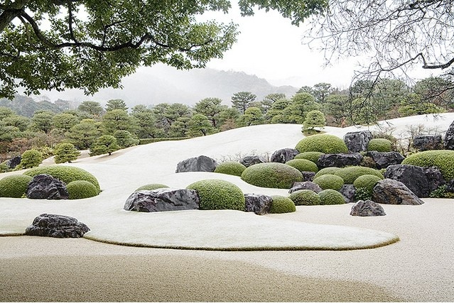 "snow-powdered garden at the Adachi Museum of Art, Yasugi, Shimane, Japan  (""Adachi Zenko, the museum's founder, traveled all across Japan, collecting pine trees and rocks for the landscape gardens and putting his heart and soul into their creation."") - photo by AsianInsights on flickr)"