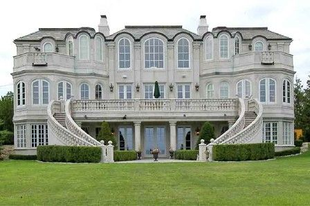 Insanely huge house in Grand Beach, MI; almost 9,000 square feet and 18 rooms (9 of them being bedrooms)! Listed at $4.6 million...that is seriously crazy, lol.