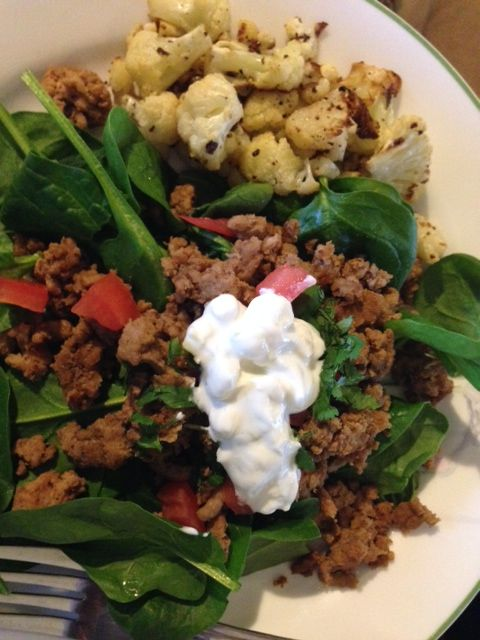 Taco Salad from Bob Harper's book, Jumpstart to Skinny. Turkey meat, loads of spices, tomato, spinach, greek yogurt with green onions, and roasted cauliflower.