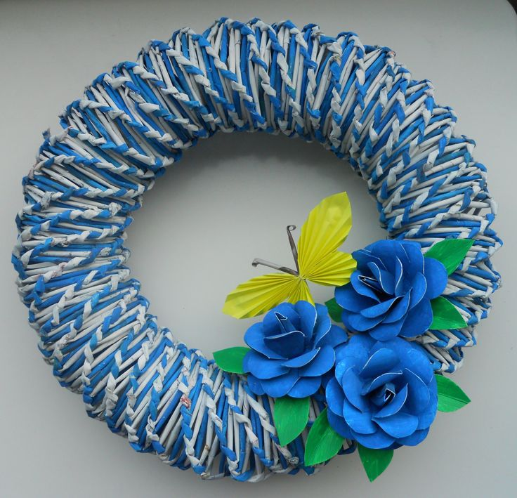 This wreath is made from newspaper. Roses are made from toilet paper rolls.