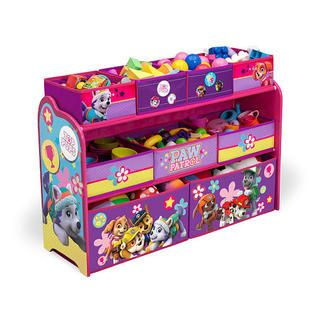 Rescue the playroom from clutter with this Nickelodeon Paw Patrol Skye and Everest Deluxe Multi-Bin Toy Organizer from Delta Children! Built to withstand whatever kids throw its way, this storage piece features nine uniquely sized fabric bins supported by a sturdy frame. Finished with colorful graphics of Skye, Everest and Marshall, it allows PAW Patrol fans to relive high-stakes rescue missions each time they clean up.  The Nickelodeon Paw Patrol Skye and Everest Deluxe Multi-Bin Toy…