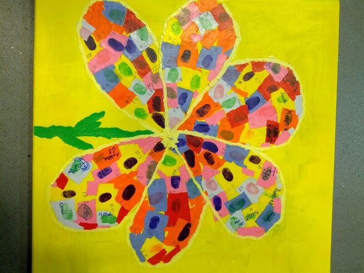 A thank-you collage; fingerprints of every child forms the flower