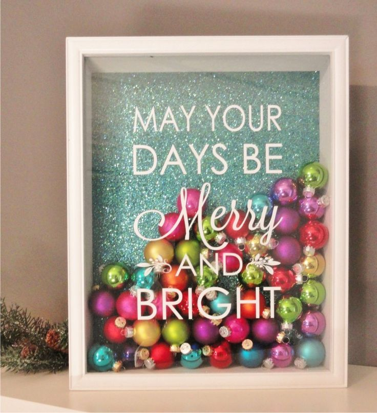 "Shadow Box Fame. With scrapbook paper, 'small' colored ornaments & vinyl saying: ""MAY YOUR DAYS BE MERRY AND BRIGHT."" :)"