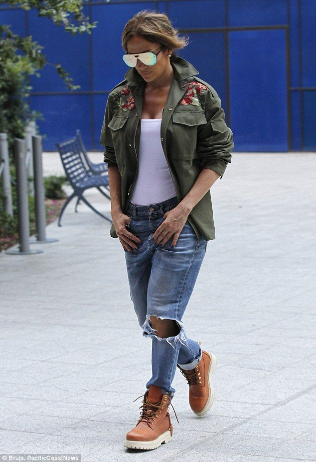 She's got good jeans! Looking defiantly street smart, the chart-topper displayed her assets in a pair of ripped Gucci jeans, which offered just a hint of her toned legs