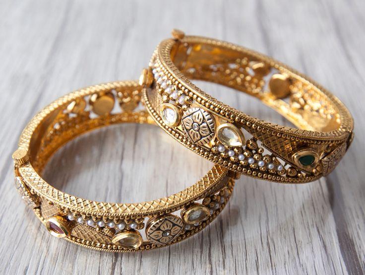 Aavarnas' Bangle Collection. Beautiful antique gold bangle with intricate design. Now available online.  Visit us at www.aavarna.com Like us on FB: Aavarna  #bridesmaid #indianwedding #wedding #jewelry #bollywood #indianfashion #shaadi #indianbride #hindubride #earrings #forsale #bollywoodfashion #indianfashion #jhumka #fashion #designinspiration #bangles #asianbride #onestopweddingsh #bridalwear #kundan #baju #traditional #stunning #instafashion #fashiontrend #aavarna #southindianfashion…