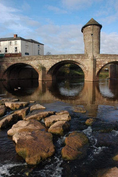 Monnow Bridge in Monmouth, Wales, is the only remaining mediæval fortified river bridge in Great Britain with its gate tower still standing in place. It crosses the River Monnow (Welsh: Afon Mynwy). The existing bridge was completed in the late 13th century.