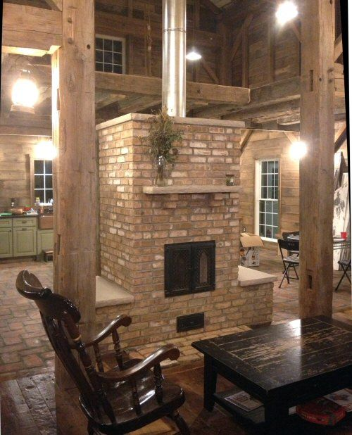 Mass Heater: Contraflow masonry heater. Brick contraflow heater with heated benches and rear oven. I love the look of this and that it is dual use! We want ours in the middle of the main living area so as to heat the whole (small) house as efficiently as possible.