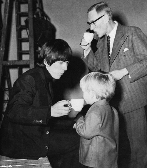 "1964 - George Harrison and Wilfrid Brambell having tea with Richard Lester's son in A Hard Day's Night film (backstage photo).  ""He's very clean."""