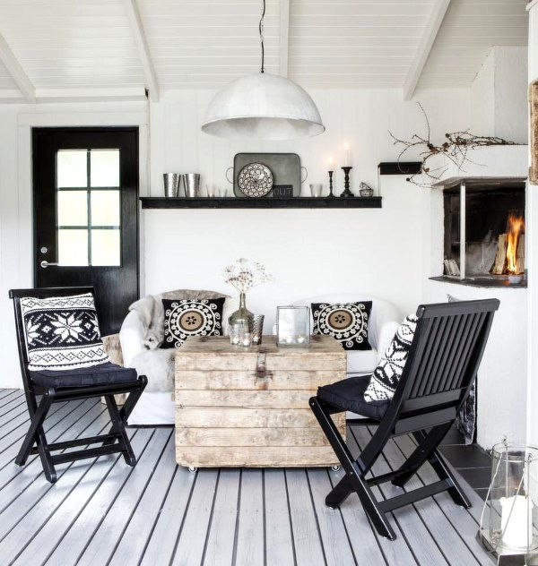 CASA TRES CHIC: P & B SCANDINAVIAN..chairs, table, fireplace for small living room. Love the black and white.