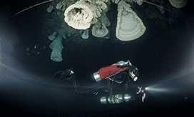 Сенот Zapote, или Hell Bells, удивительная пещера с громадными колокольчиками растущими в вечной тьме.