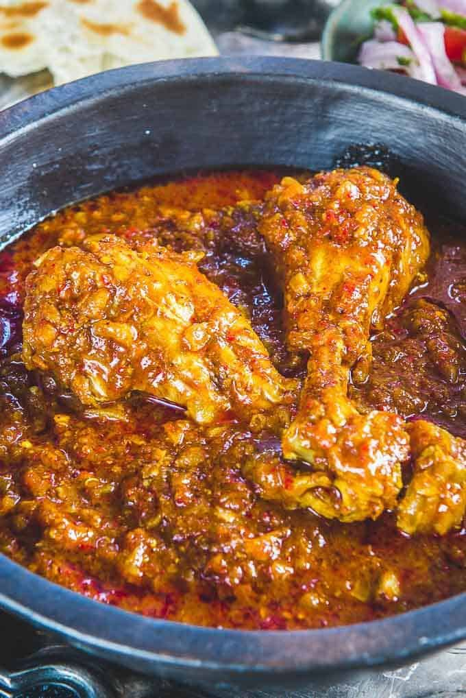 Close up shot of chicken vindaloo served in a serving bowl
