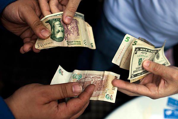 1 Argentine Peso equals  0.18 US Dollar