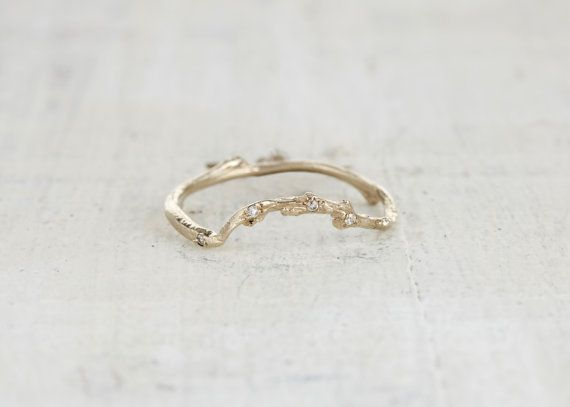 A delicate solid 14kt recycled gold twig set with eight VS diamonds or brilliant blue sapphires designed to curve around and fit snuggly with the