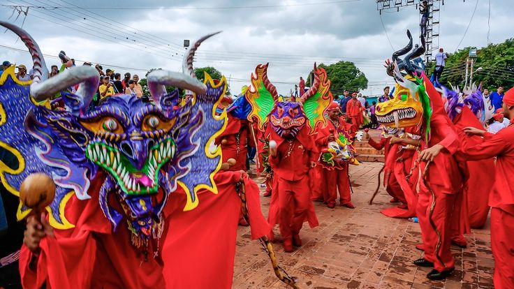 How do Venezuelans celebrate the Feast of Corpus Christi? By dressing up in devil costumes and dancing through the streets, of course.