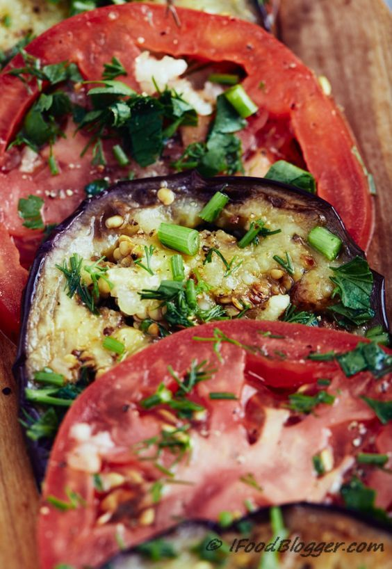This low calorie eggplant recipe is very easy to make and I am sure you are going to love it. Vegan low carb gluten free and paleo friendly. These marinated eggplants and tomatoes can be served as an appetizer as a side dish in place of a salad or just by themselves. They are that good.