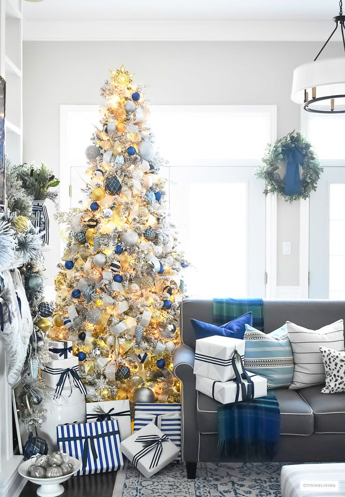 Flocked Christmas Tree With Navy Light Blue Silver And Gold Ornaments Blue Christmas Decor Gold Christmas Decorations Gold Christmas Tree Decorations