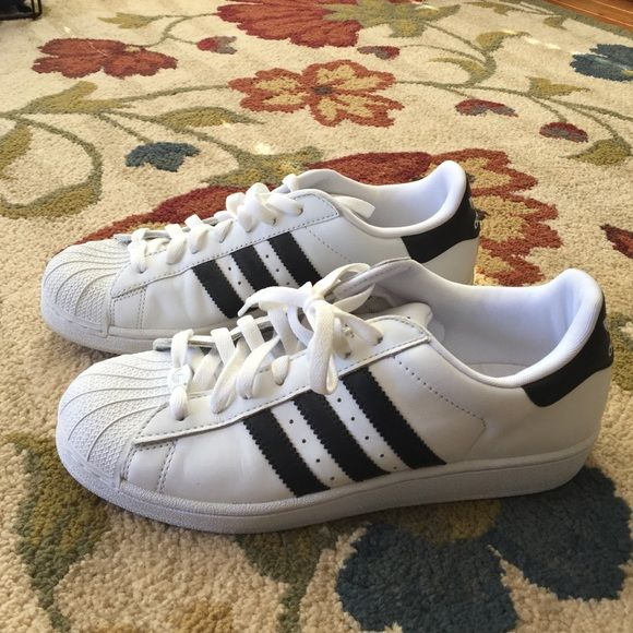 Men's brand new Adidas Shoes Men's Size 9. Never worn. Perfect condition like they were just bought. Adidas Shoes Athletic Shoes