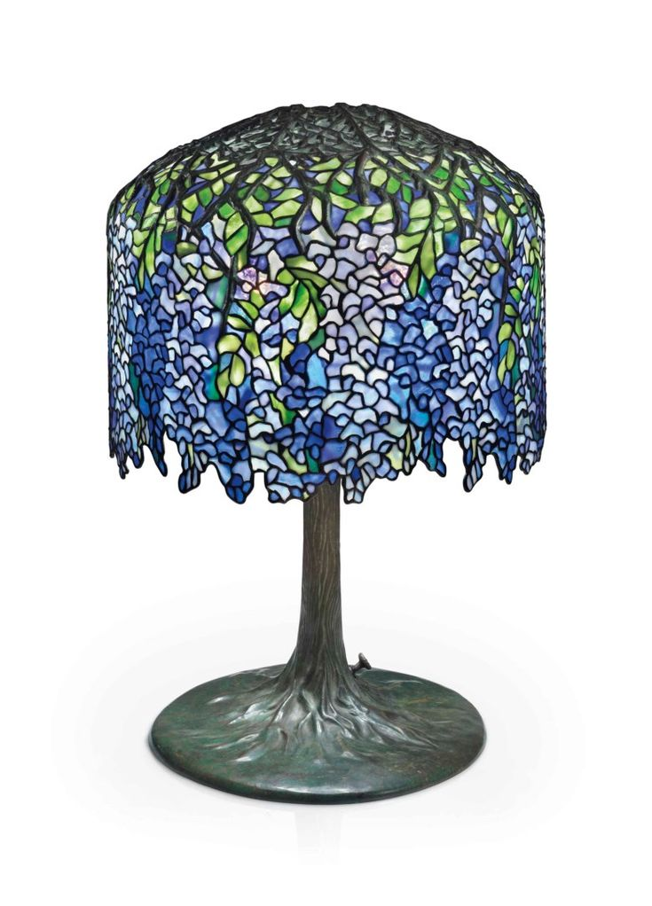 Tiffany Studios, A Wisteria leaded glass and bronze table lamp, circa 1905. 26½  in (68  cm) high, 18  in (45.8  cm) diameter of shade. This lot was offered in theDesignsale on 14 December 2017  at Christie's in New York and sold for $492,500