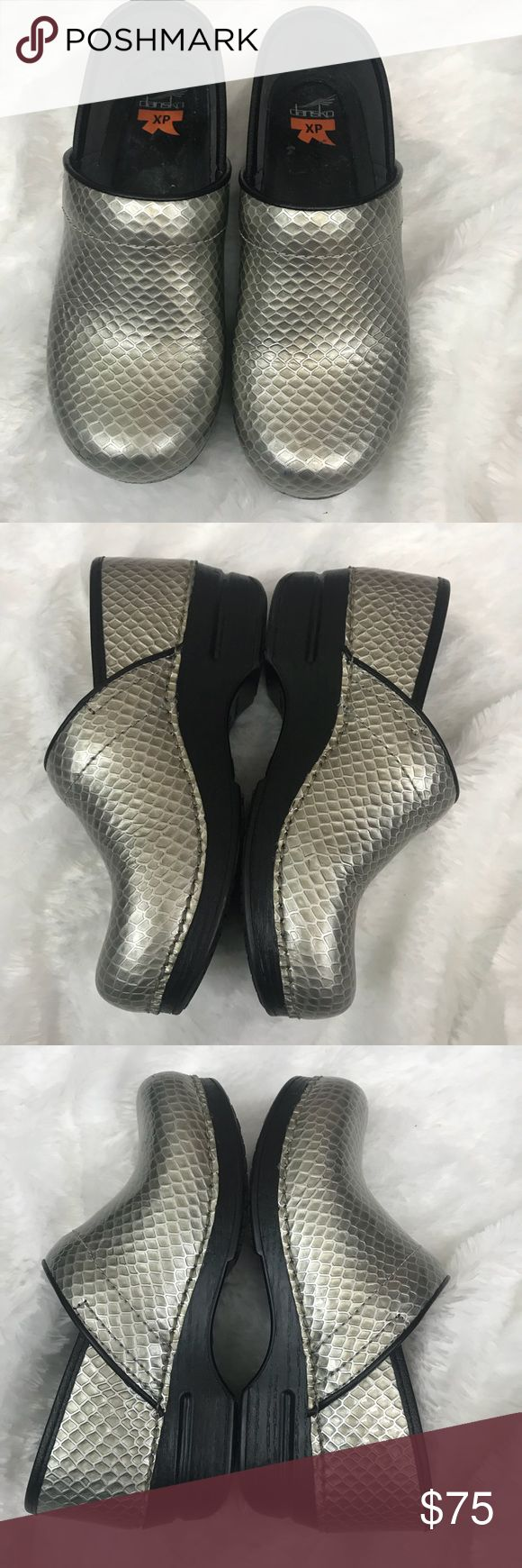 Dansko Clogs size 38 Silver Snake These Clogs are awesome! So comfortable!  Size 38 which is a women's 7.5-8 according to their size chart. Textured muted silver. A couple small scraps pictured. Soles shoe hardly any wear. Dansko Shoes Mules & Clogs