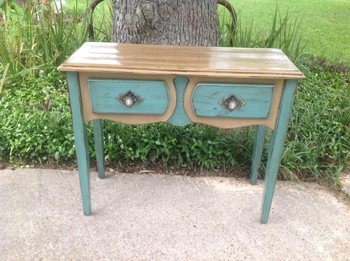 Here is one of our fabulous entry tables! We love to change the look of old furniture by creating interesting paint combinations and of course adding bling! Check out our Facebook page for more awesome distressed furniture!