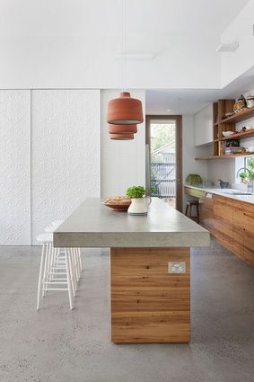 Martin House   BG Architecture [Melbourne, Australia] Features include: Timber and concrete kitchen, and beautiful 3D white tiles add texture to white walls In refined elegance.