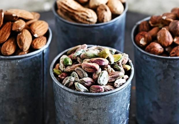High-Calorie Foods That Are Good for Your Health  Selection of nuts on table in pots, 10 healthy high calorie foods