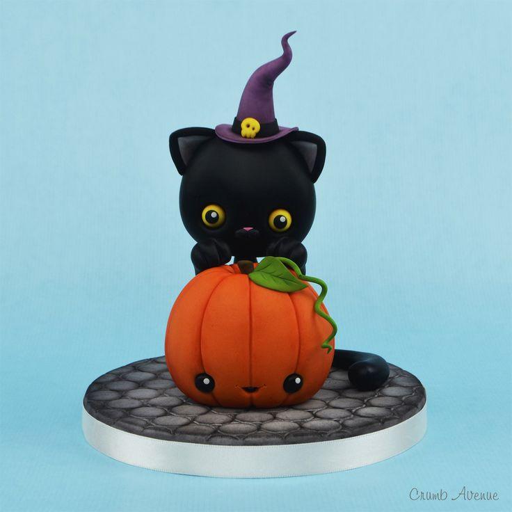 Halloween pumpkin and a cat