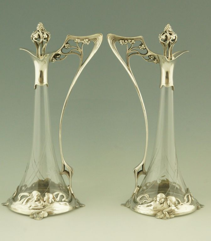 A pair of art nouveau claret jugs with ladies by WMF.  Germany.  1906