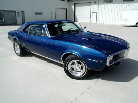 "1967 Pontiac Firebird, ""babies came the car got sold, i sure do miss that old hot rod."" and i do miss it. blue with a black vinyl top"