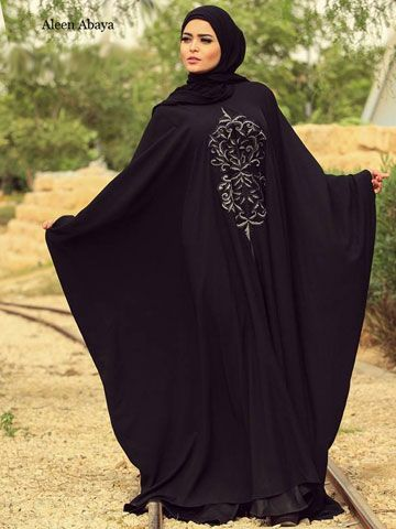 """Janah Butterfly Abaya Butterfly style abaya """"Malhafa"""" decorated by embroidered on bodice, Underneath the abaya there is a ribbon to tighten abaya under bust line.. Hijab (scarf) is optional size 75cm x 2cm / 29.5"""" x 78.7"""" and made of Chiffon. Fabric: High quality Korean Crepe Washing Instructions: Machine Wash Tailored and designed by """"Nesma"""""""