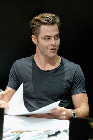 Actor Chris Pine from the 2017 feature film Wonder Woman signs autographs for fans in DC's 2016 San Diego ComicCon booth at San Diego Convention...