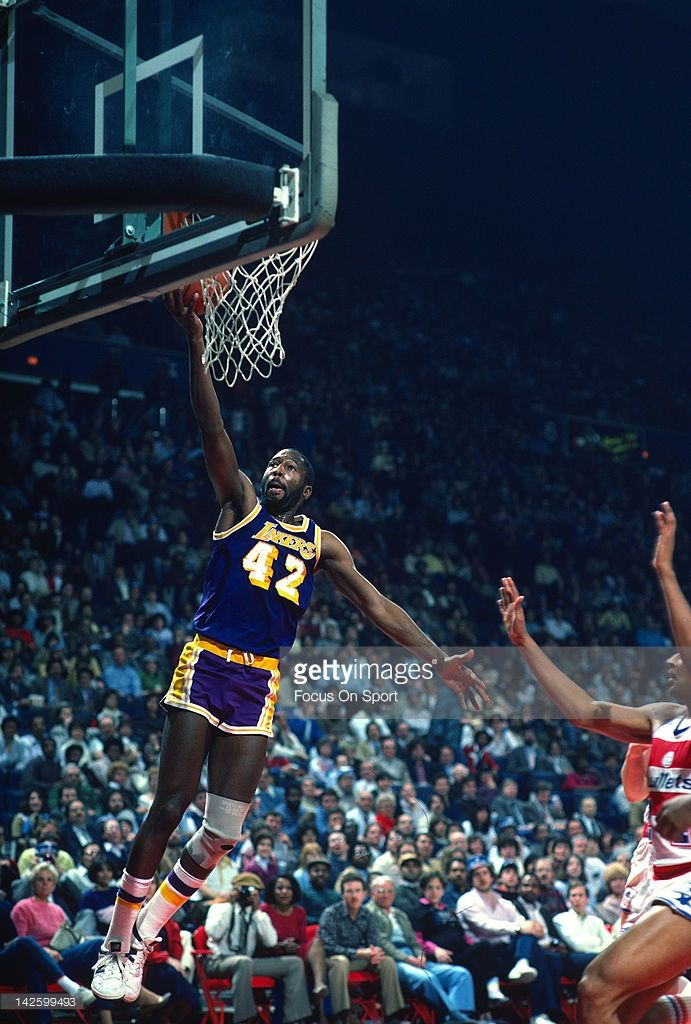 James Worthy #42 of the Los Angeles Lakers lays the ball up against the Washington Bullets during an NBA basketball game circa 1984 at the Capital Centre in Landover, Maryland. Worthy played for the Lakers from 1982-94.