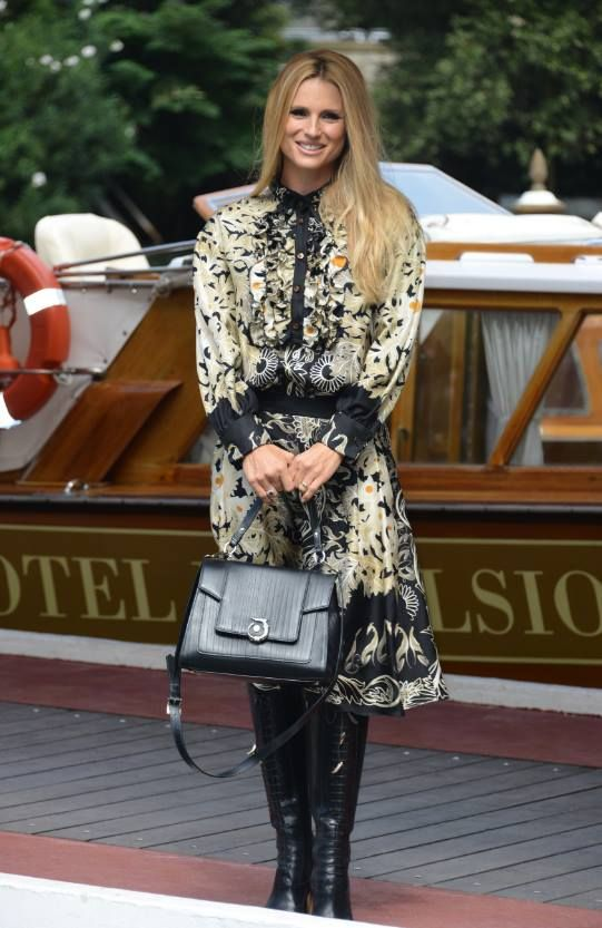 "Michelle Hunziker shines in a TRUSSARDI silk dress from the Fall Winter 2016/17 collection and the iconic #LOVYBag at her arrival for the presentation of the short movie ""L'Amore che vorrei"", a project by Doppia Difesa Onlus, at the 73rd Venice Film Festival. #LOVYLover"