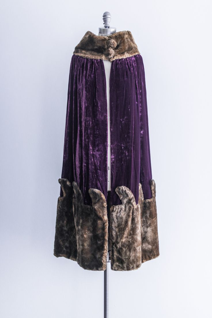 - Overview - Care - Shipping - DESCRIPTION: Gorgeous royal purple silk velvet cape lined with silk satin and embellished with faux fur trim. CONDITION: Great. No blemishes on the outside, a small tear