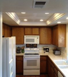 Changing the kitchen fluorescent box light fixtures. Like the use of crown molding and recessed lighting.