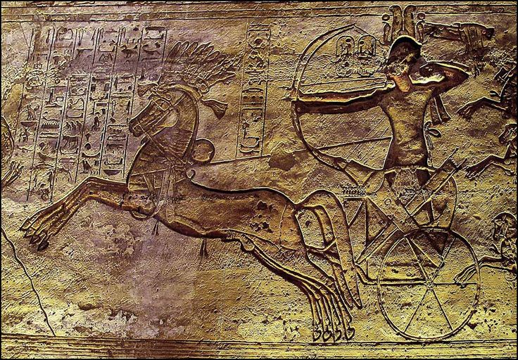 Rameses II and chariot at the Battle of Kadesh (1274 BC). Ancient Egyptian relief inside his Abu Simbel temple, Nubia, Southern Egypt.