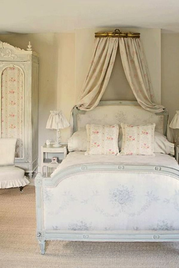Charming French country bedroom with floral upholstered bed, armoire and canopy. Romantic European Farmhouse Bedroom Decor Ideas!