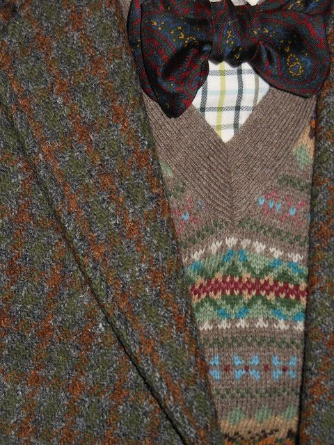 Multiple patterns and textures work well. Tweed, tattersall check shirt, silk paisley bow tie, fair isle knit jumper.