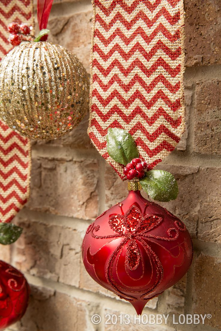 Hang ornaments from lengths of festive burlap ribbon. Then accent them with winter leaves and berries, clipped from seasonal floral picks.