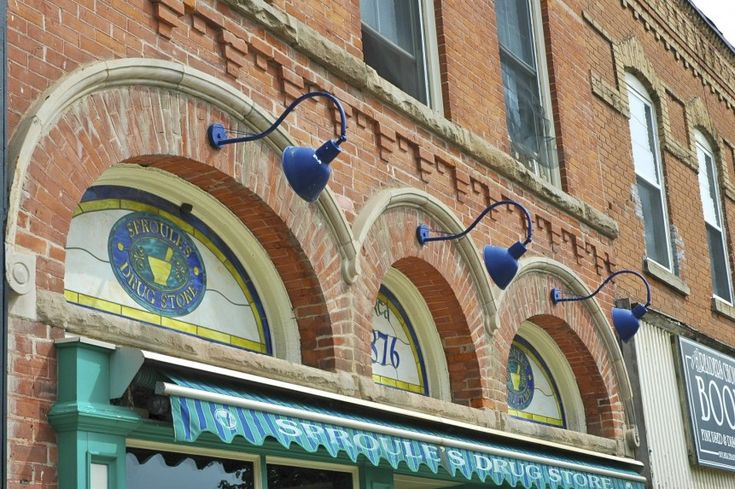 Stained Glass Facade of Sproule's Drugstore  Sproule's Drugstore has been around since 1876. Its facade is decorated with stained glass in its window arches and decorative brick work.