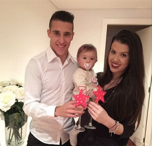 Cristian Tello with Loren Lopez and their daughter Carlota