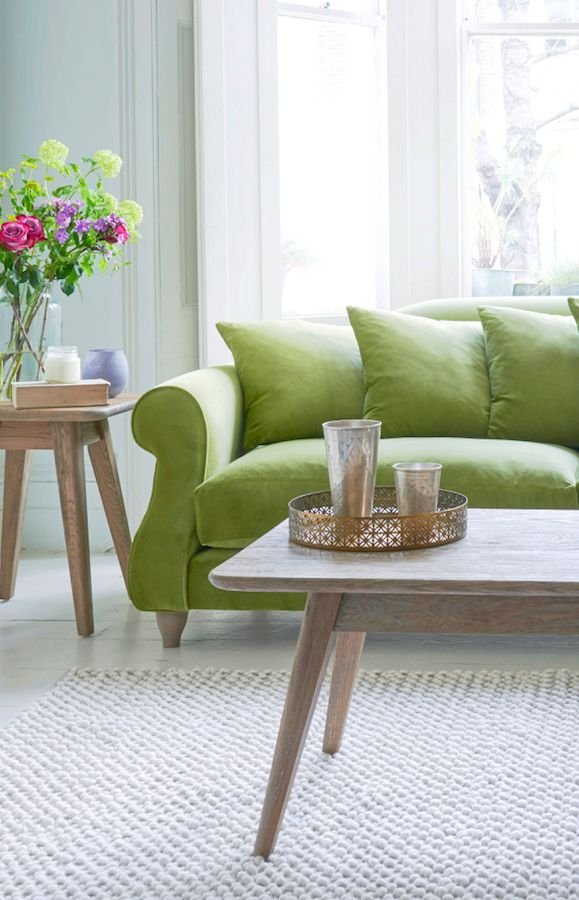 Loaf's green velvet Sloucher sofa with spring blooms